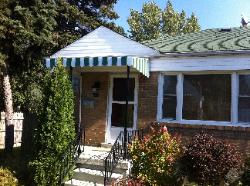green and white aluminum awning