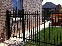 black aluminum fence and gate