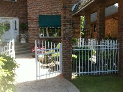 white aluminum fence and gate